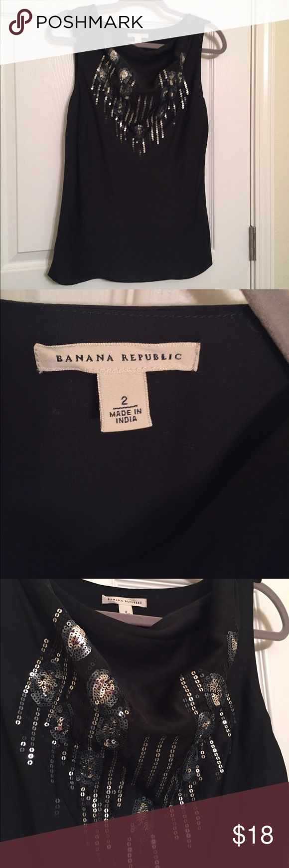 Banana Republic black blouse Flattering neckline, sequined bodice, sheer overlay, fully lined, zip up side, hangs long and loose, size 2 Banana Republic Tops Blouses