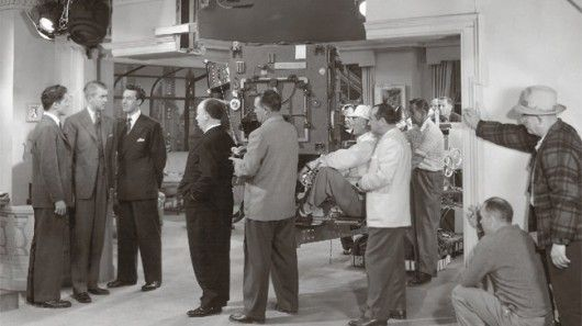 Hitchcock on the set of Rope, with actors Jimmy Steward, John Dall, and Farley Granger. Image Courtesy of nai010 publishers