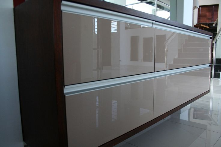 Server with glass doors, aluminium finger grips and mahogany surrounds