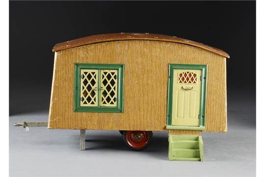 A rare Tri-ang caravan 1950s, wooden two-wheeled trailer covered in wood effect paper, tinplate w