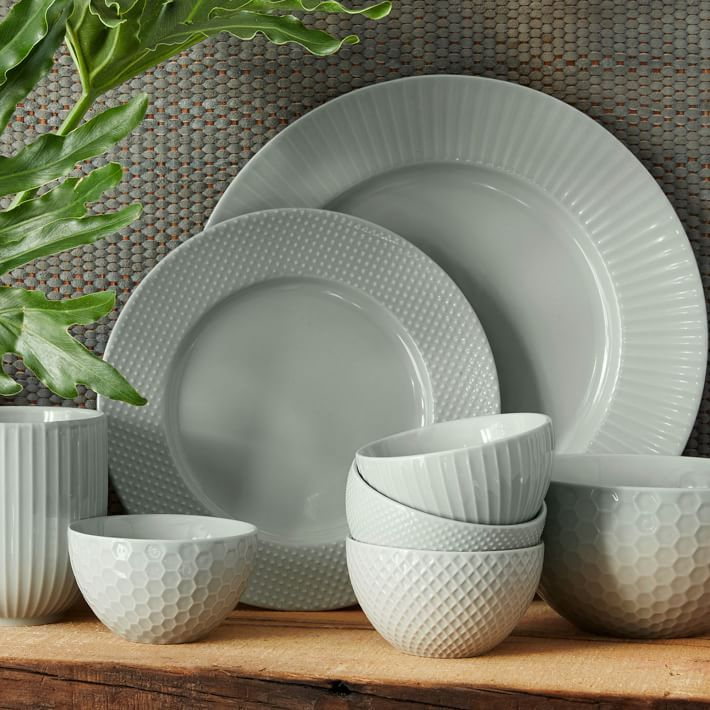 Add soft color to your tabletop with our stoneware Textured Dinnerware Set. Each piece features graphic textural dots or lines.