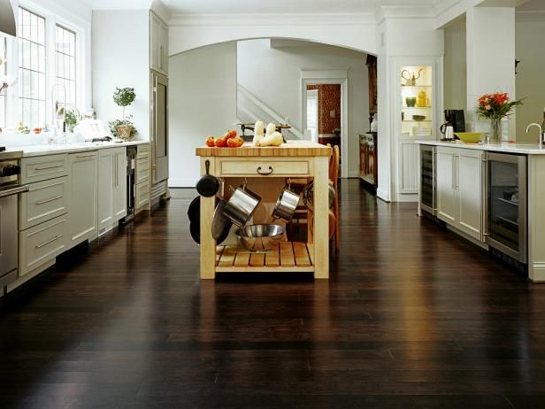 Bamboo is an eco-friendly flooring material that is more resistant to water, stains, damage, and warping than hardwood flooring.