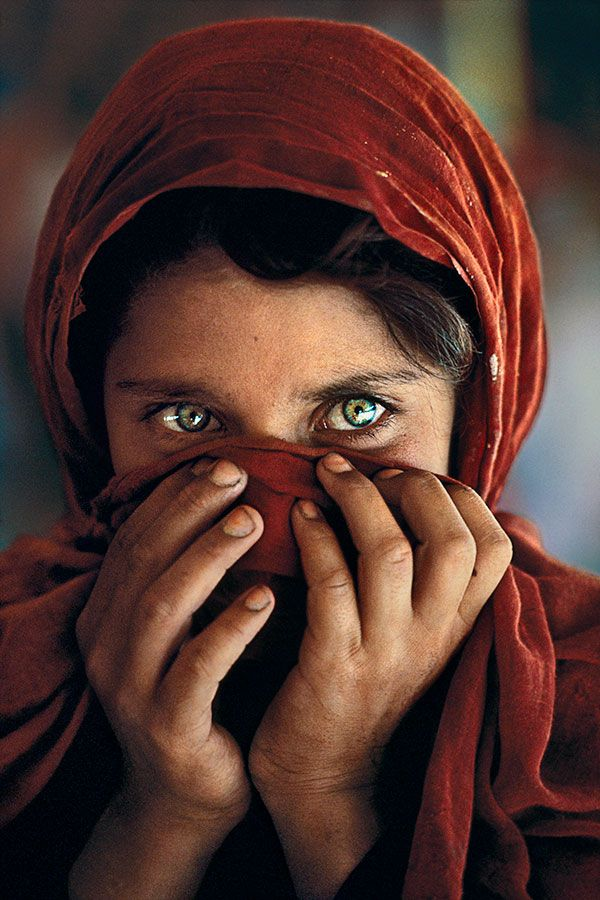 """Silent Language of Hands"" - Sharbat Gula, Nasir Bagh Refugee Camp, Peshawar, Pakistan, by Steve McCurry."