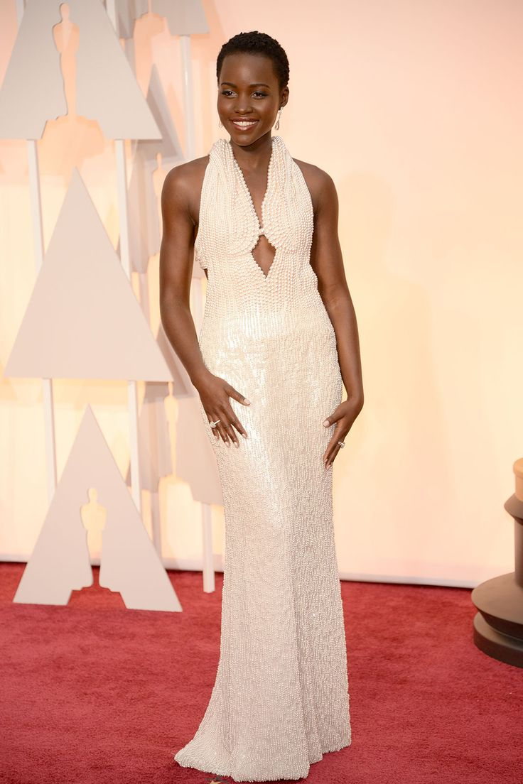 Who could forget Lupita Nyong'o's stream of red carpet hits from last year's awards season? So, what does one do to top it in 2015? Make an entrance in a custom Calvin Klein Collection design, of course. This delighted us most because it looked like a full-body piece of pearl-encrusted jewelry. Consider 2014 topped.