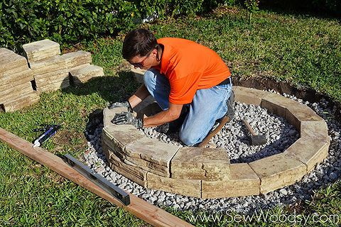 how to build an outdoor fire pit, diy renovations projects, outdoor living, Watch our video on how to build an outdoor fire pit