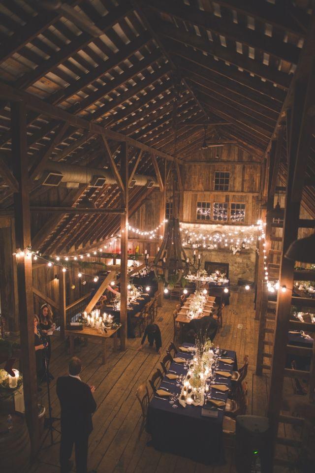 Wedding -- barn + string lights + long tables
