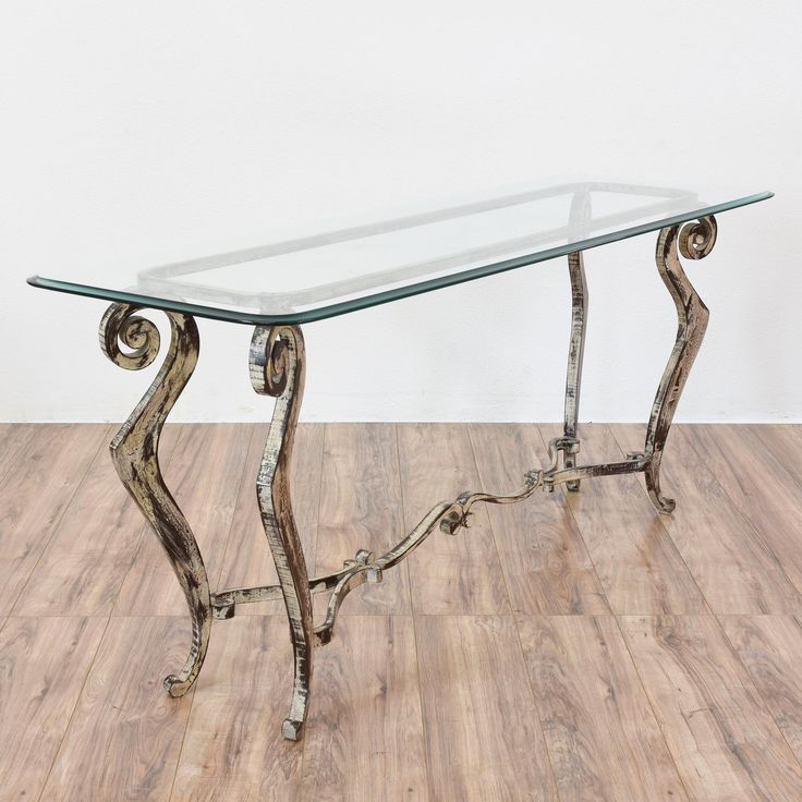 This splendid sofa table is made of distressed wrought iron. The table has a removable glass top. Slender in stature, this would also be a perfect console table. The curved legs are sturdy. Add a little Mediterranean style to your living room! #mediterranean #tables #consoletable #sandiegovintage #vintagefurniture