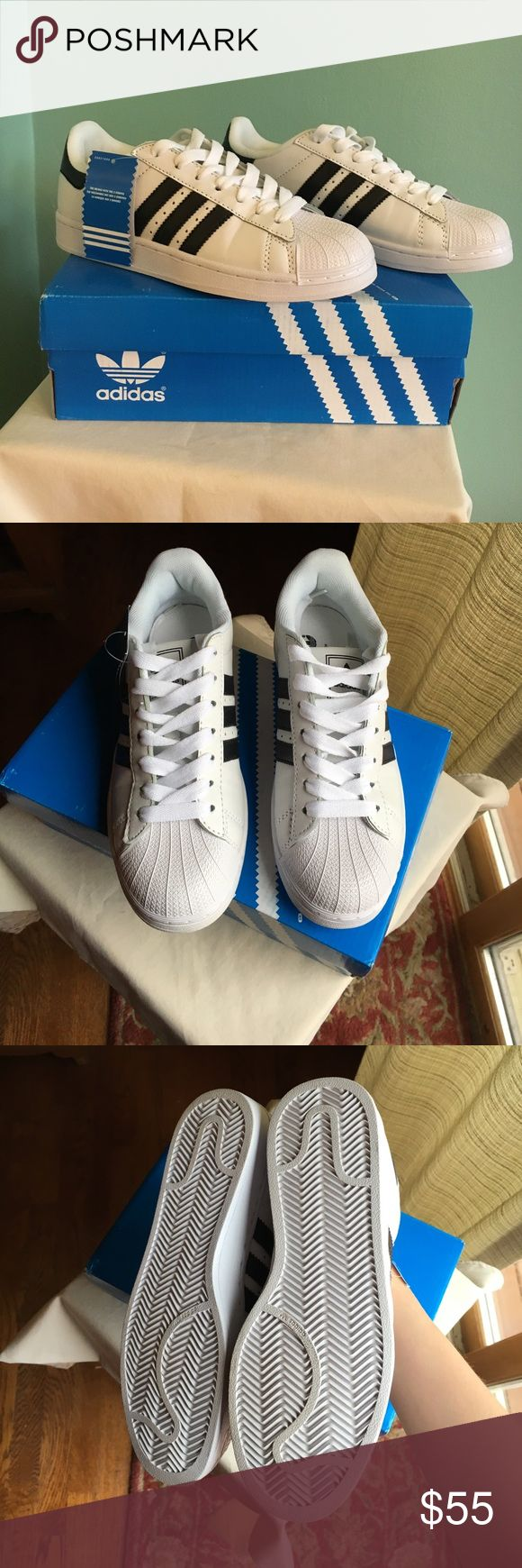 Adidas, Superstar shoes! Very good condition, never worn, still has tags and is still in the box! 6 1/2 in a woman's shoes and 5 in men's. Adidas Shoes Sneakers