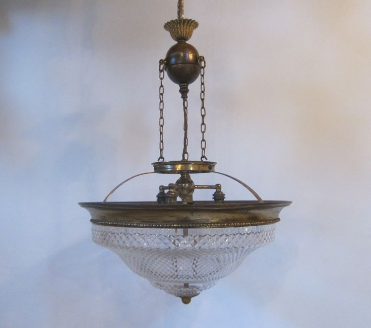 Good size english pendant light in the original brass finish with fittings for three light bulbs
