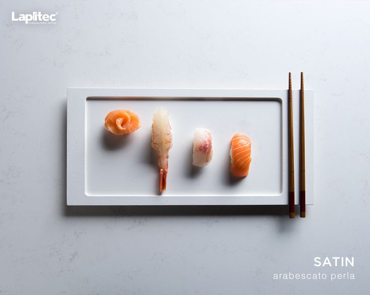 Surfaces so sleek for plates so chic. Lapitec®'s Satin finish in Arabescato Perla is the perfect backdrop to any meal.