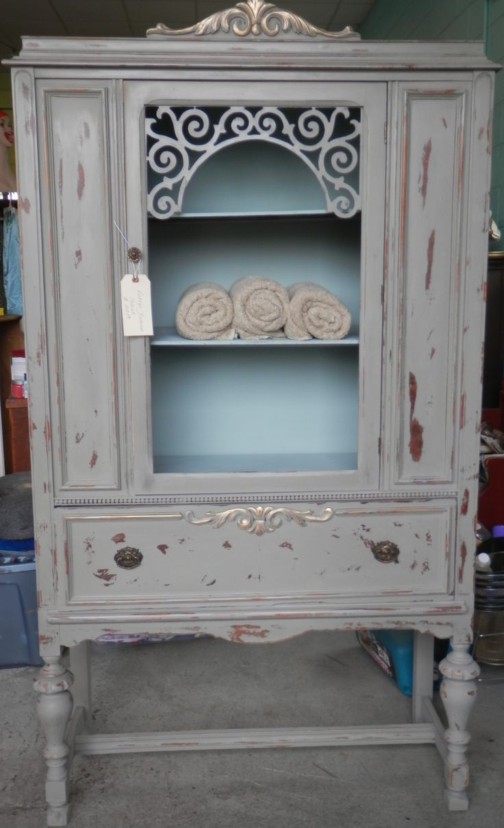 This was an antique depression era china cabinet and I painted it with