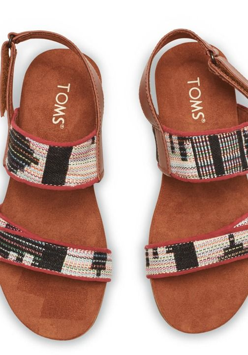 You can look at this slingback sandal in a couple of ways: Are the two straps there for support, or to showcase the excellent materials?