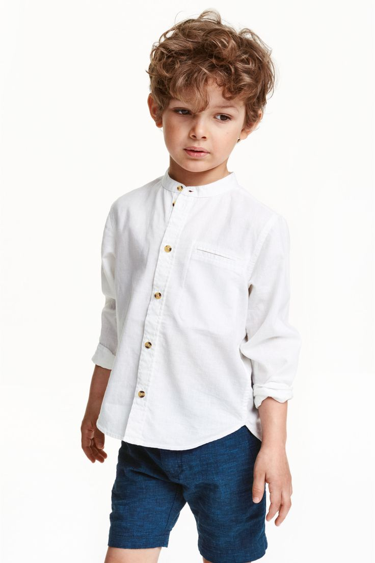 Collarless shirt: Collarless, long-sleeved, shirt in an airy weave with a jetted chest pocket and a rounded hem. Slightly longer at the back.