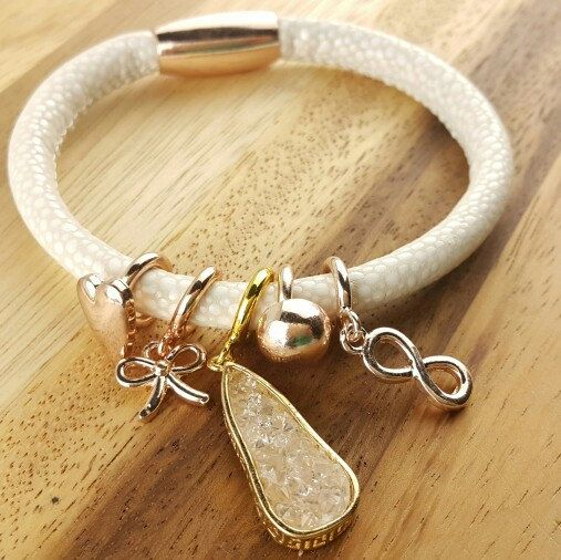 Endless leather bracelet one loop price at 10usd only and variety of charm cubic,pearl,birthstone staring at 1.5usd only...create your cool wrap bracelet at your choice every days....