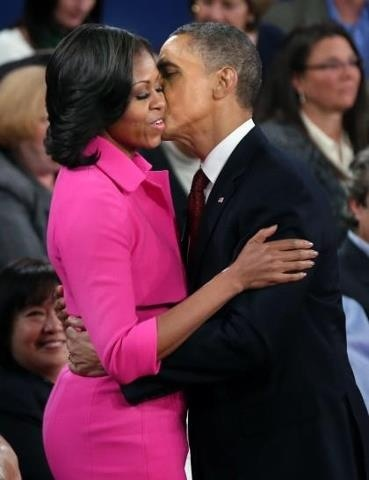 Michelle and Barack Obama embrace at the conclusion of the second presidential debate held in October 2012.
