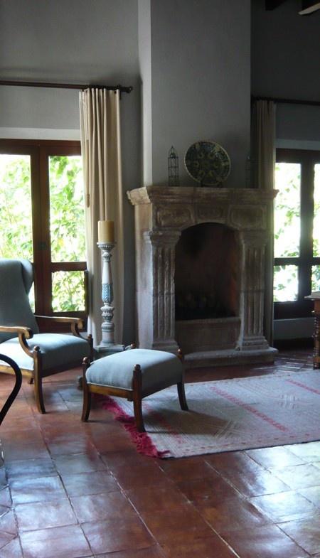Fireplace & saltillo tile floor.