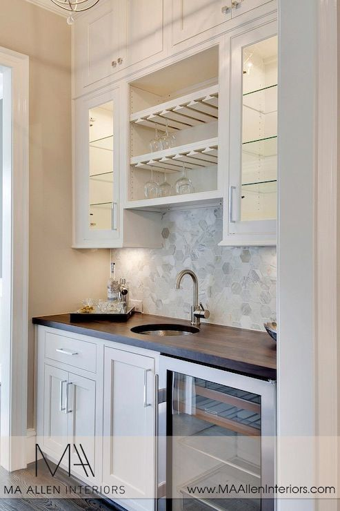 Butlers pantry design with glass-front upper cabinets and inset lower cabinets plus wine cooler