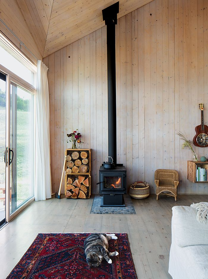 Garlick left the prefabricated structural panels unfinished to save on  material costs. A True North wood stove from Pacific Energy heats the house. - 602 Best Images About Stick Stacks -Home Fires On Pinterest