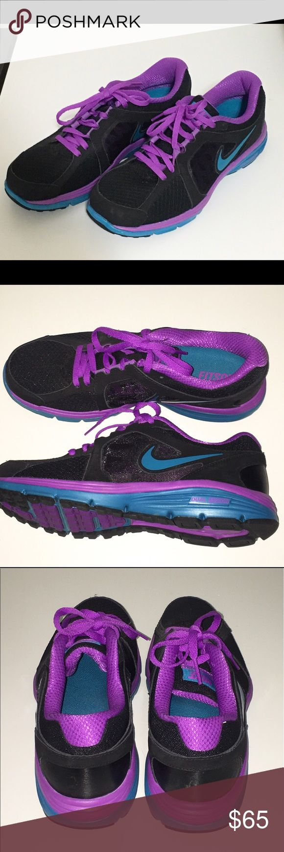NIKE dual fusion running shoe NIKE dual fusion running shoe size 9. Excellent condition only worn once. Black with blue and purple design. Nike Shoes Athletic Shoes