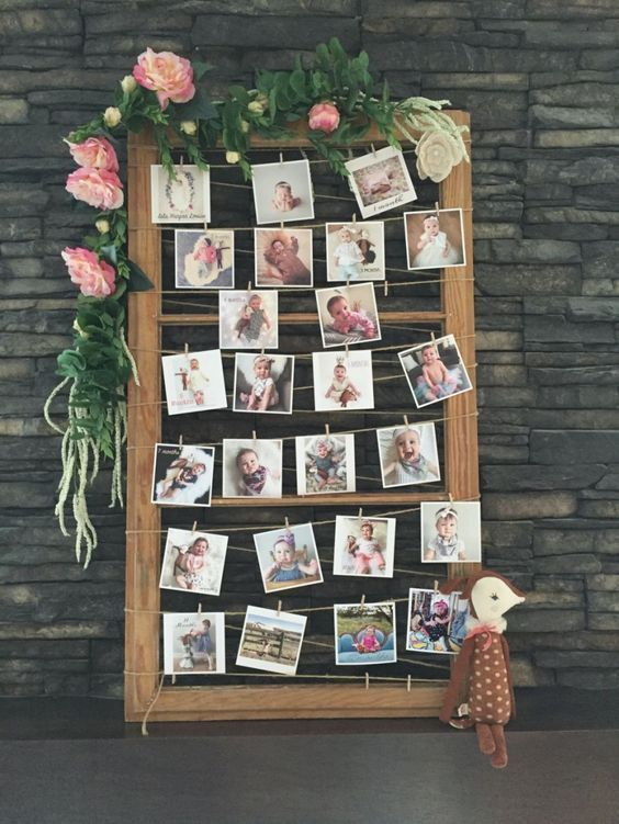 Photo display for a magical woodland themed birthday party / http://www.deerpearlflowers.com/wedding-photo-display-ideas/