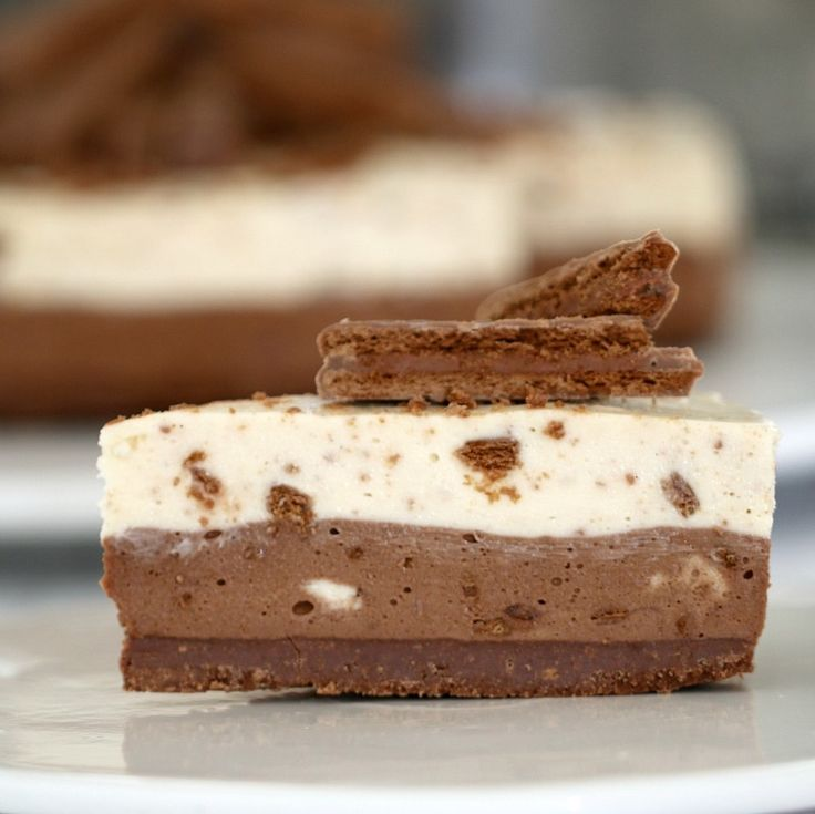 It doesn't get any more delicious than this No-Bake Double Layer Tim Tam Cheesecake! With a Tim Tam base, milk and white chocolate layers sprinkled with Tim Tam chunks and extra Tim Tams on top, this really is a chocoholics dream.