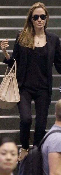 Who made  Angelina Jolie's black flat sandals and tan tote handbag that she wore  in Tokyo?