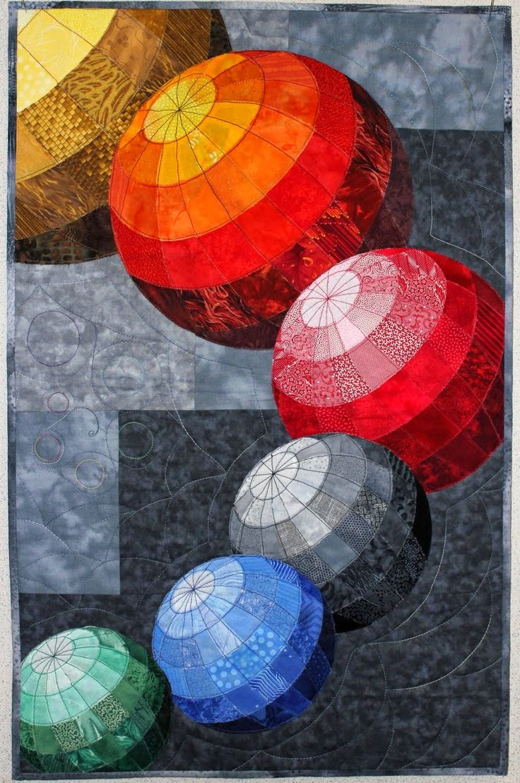 """Spheres"", 18"" x 28"", by Karren Lusignan.  Mountain Art Quilters: 2015."