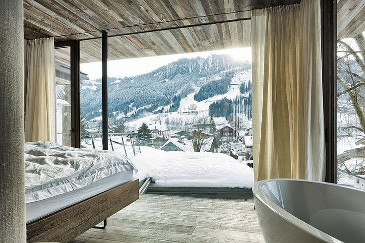 Haus Walde by Gogl Architekten. It is a little strange to have a tub in your bedroom, but I'm loving the idea especially with that view. Take a soak in a hot bath and crawl to the bed.