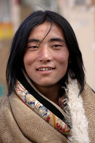 Tibetan man. The resemblance to Native Americans is very obvious here despite the 1000's of years separating genetic develoment of 2 the peoples. ** A handsome man with a lovely gentle face.