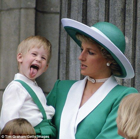 Harry sticks out of his tongue while with his mother Diana on the balcony of Buckingham Palace