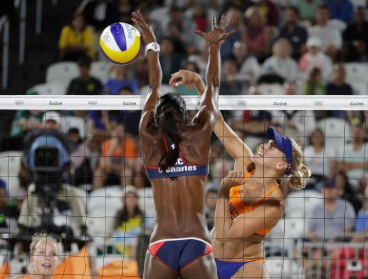 Netherland's Marleen van Iersel, right, hits over Costa Rica's Karen Cope Charles during a women's beach volleyball match at the 2016 Summer Olympics in Rio de Janeiro, Brazil, Monday, Aug. 8, 2016.