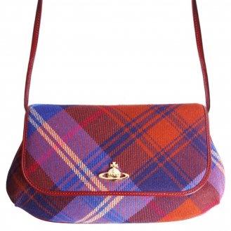 Tartan is one of the biggest features in Vivienne Westwood's collection! Check out the Vivienne Westwood purse