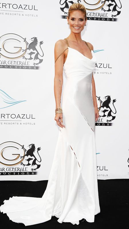 HEIDI KLUM The supermodel stepped out in this white hot Versace gown that looked effortlessly elegant.