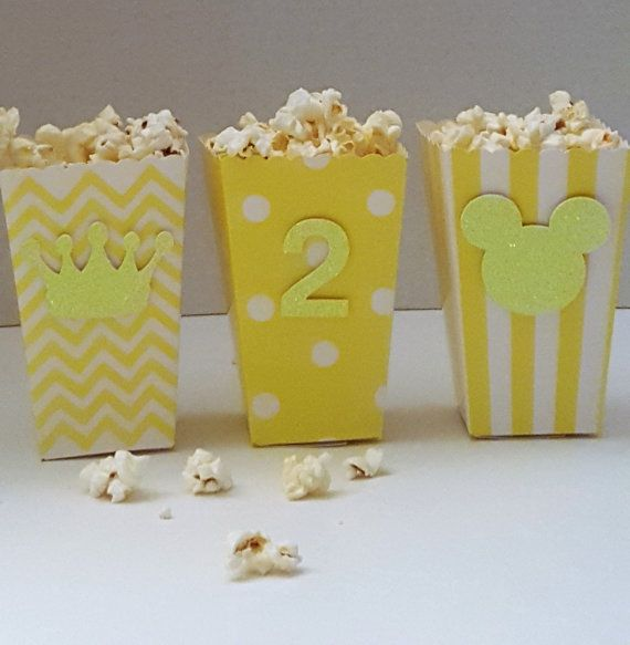 Description:  Take your movie night to the next level with these stylish popcorn containers. These chic little containers are made from high quality 300gms glitter stock card paper and come in 4 different colors and 3 different designs. If you are the creative type and have a different style or design in mind send me a message and we can try to make your creativity come to life. These adorable little containers are perfect for a movie themed wedding; your guests can splurge on popcorn and…