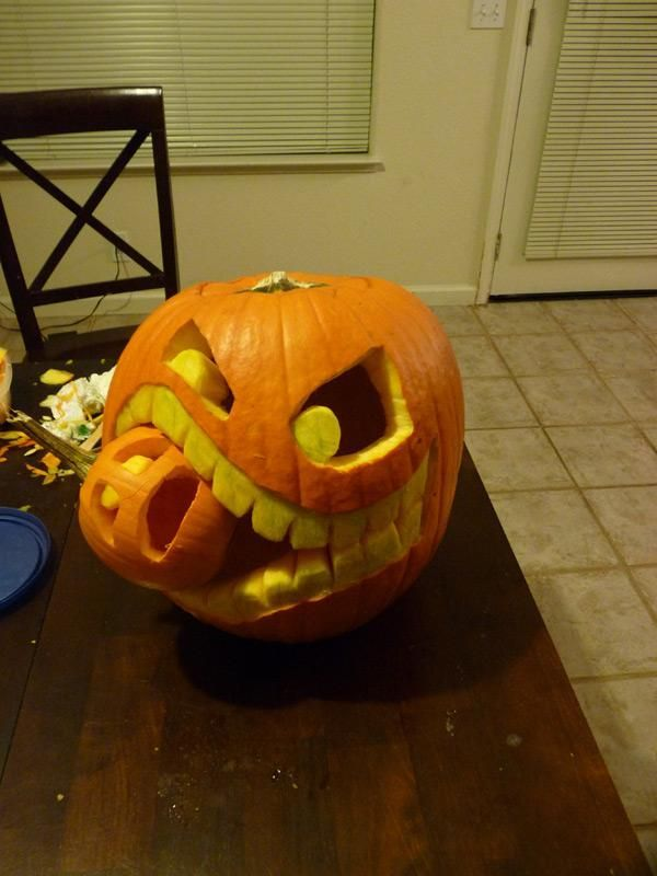DIY Cannibalistic Pumpkin Carving, Awesome Pumpkin Carving Ideas for Halloween Decorating, http://hative.com/awesome-pumpkin-carving-ideas-for-halloween-decorating/,