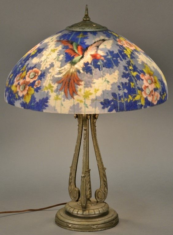 Handel blue pheasant reverse painted table lamp having colorful exotic pheasant flying above rich in color flowers and foliage against bright blue background ~ Realized Price $8,750.00    #nadeausauction