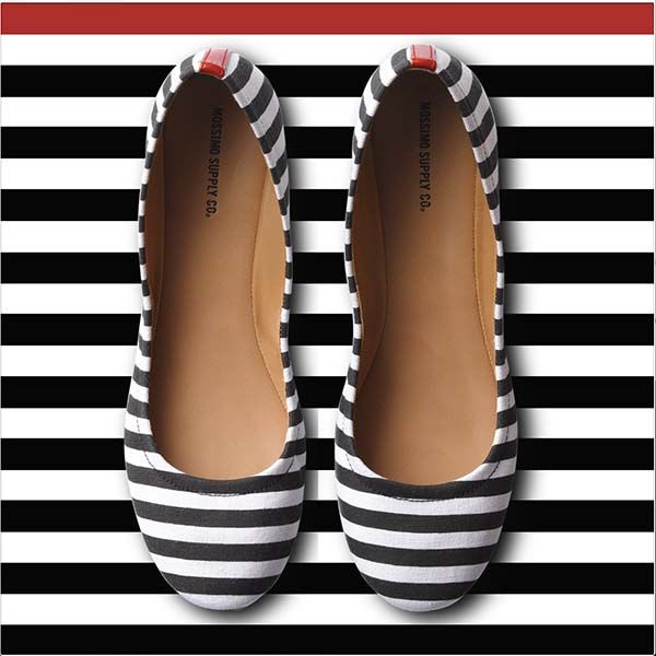 Black  white stripes make flats more sophisticated—and so cute with jeans.
