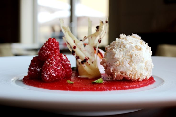 Watermelon marinated with raspberry syrup, rhubarb sponge biscuit and coconut sage ice cream