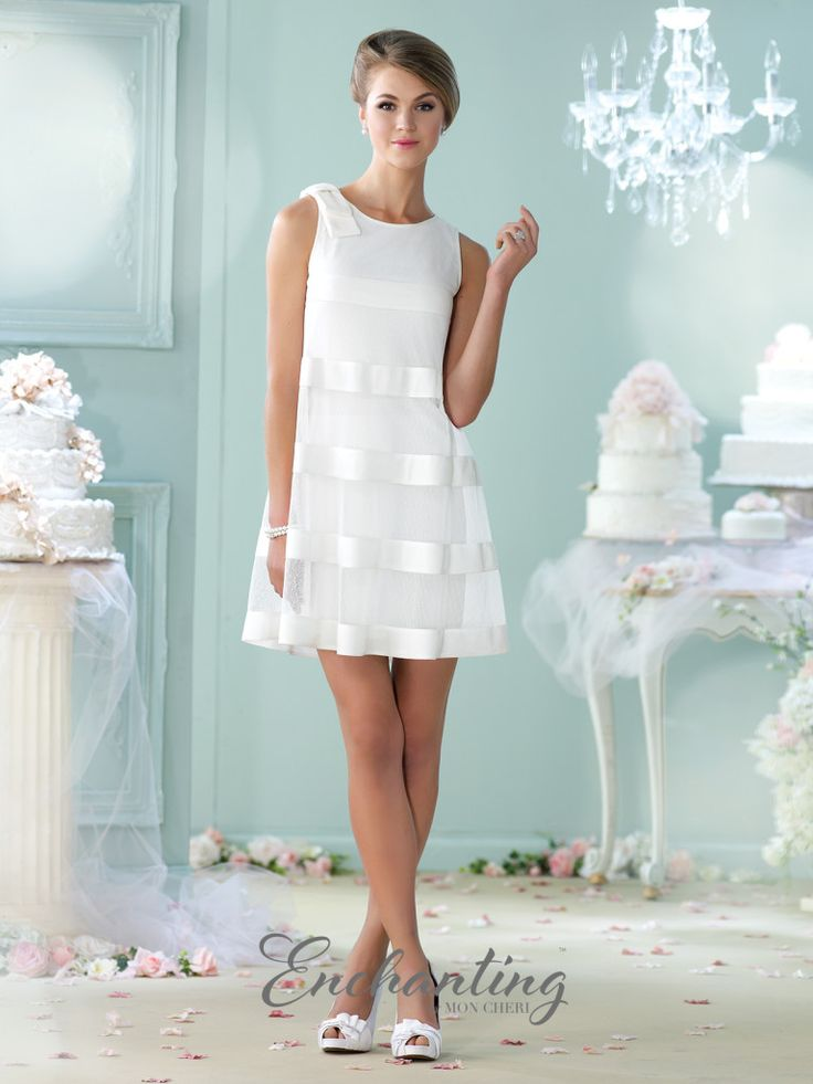Enchanting by Mon Cheri - 215112 - Sleeveless point d'esprit, satin, and jersey above-the-knee swing dress, scoop neckline with bow at shoulder, lace with satin ribbon over slim silhouette.  Sizes: 4 - 20  Color: Ivory