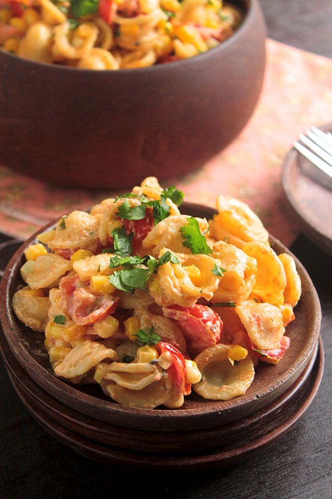 30 Minute Creamy Corn and Tomato Pasta 1 lb. orecchiette pasta 1/4 cup extra virgin olive oil salt and pepper to taste 2 cups sweet corn kernels 2 cups cherry tomatoes, quartered 1/4 cup cream cheese 1 cup fresh cilantro, chopped