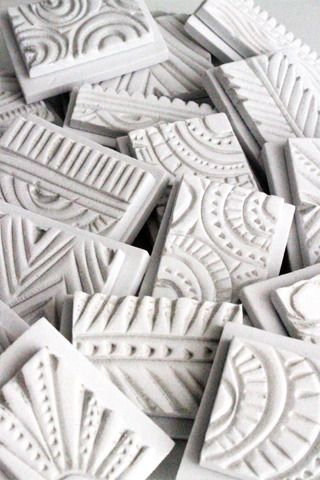 stamps made out of craft foam and carved with heat