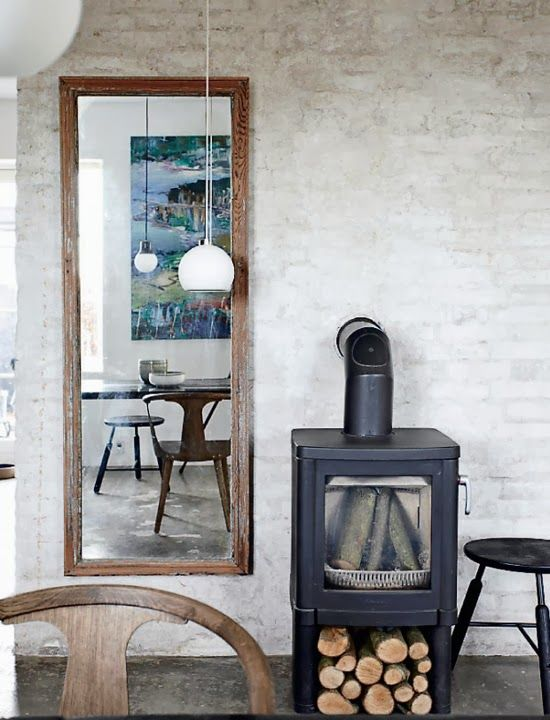Mirror beside fireplace