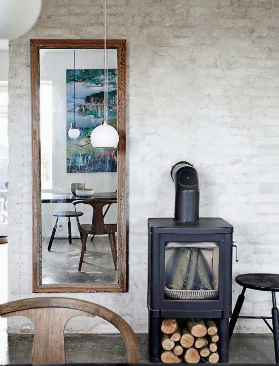 Mirror beside fireplace