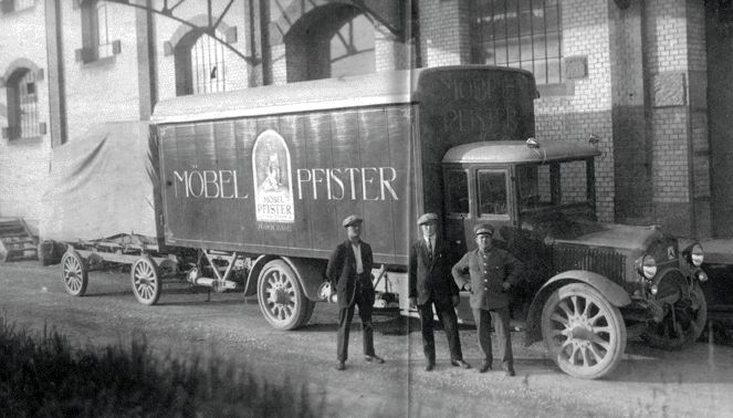 """Historic trucks of Pfister - the first """"camion"""" in 1918 allows deliveries beyond the borders of Basel."""