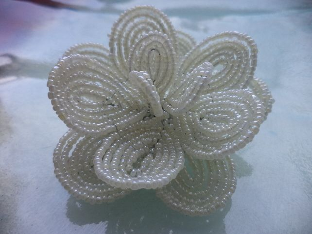 This hair clip is made of cream seed beads using the french flower beading technique.