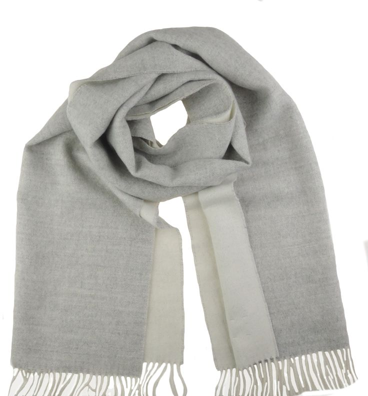 A soft and warm hand made scarf made of 100% Baby Alpaca. This two toned grey and white scarf is a real basic and timeless piece.