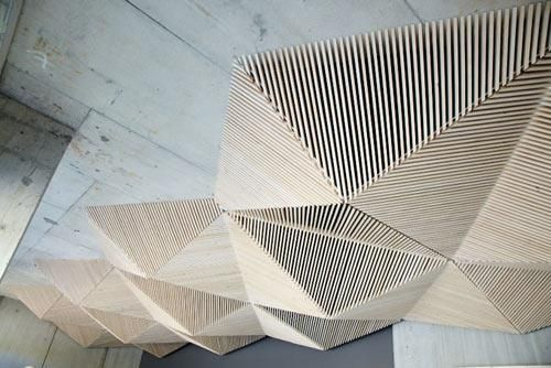 A geometric wood ceiling designed by Assemble