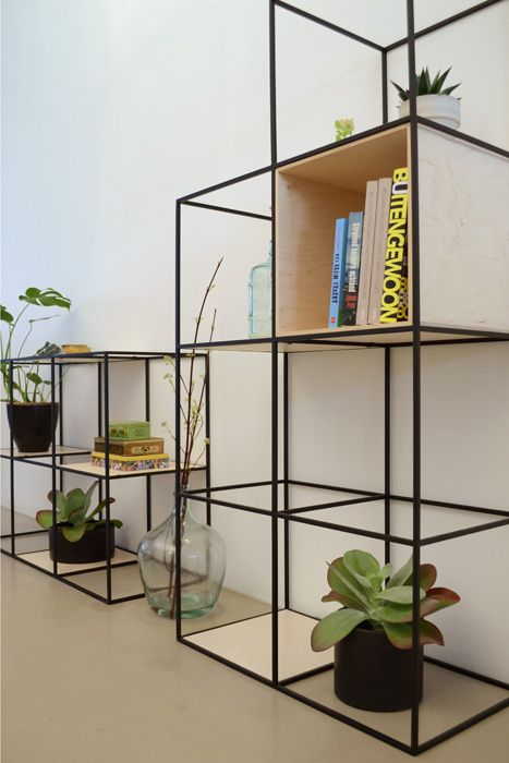 Beautiful shelf built up symmetrically and made of fine steel and plywood  #steel#shelf#wood