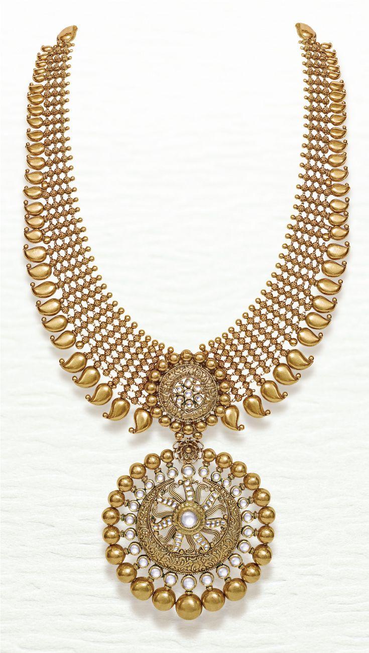 Azva contemporary bridal gold necklace of kundan stones and paisley. #Goldjewellery #luxury #style