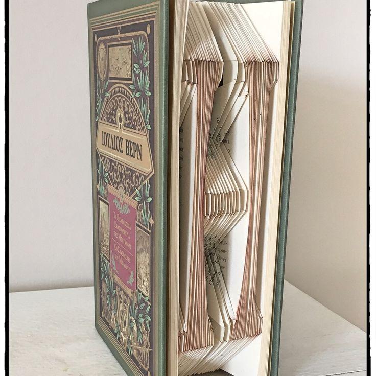 """Initial folding . """"H"""" in a Jules Verne book."""